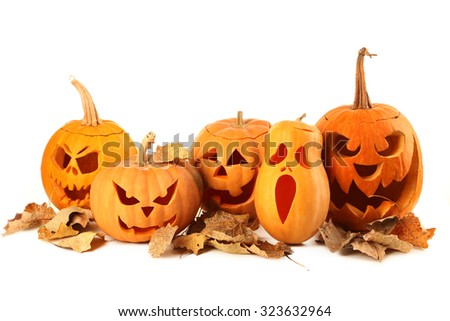 Halloween pumpkins with dry leafs isolated on a white - stock photo