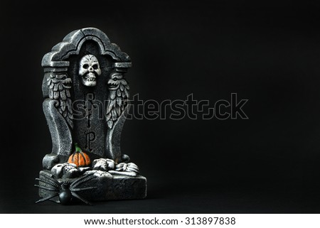 Halloween RIP tombstone with spider on black background - stock photo