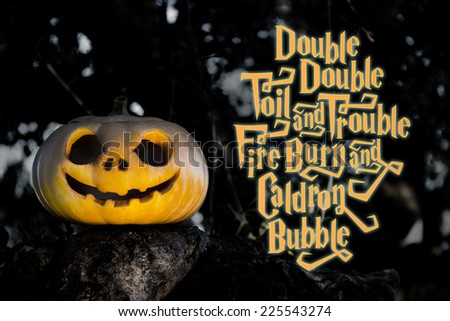 Halloween scary pumpkin jack-o-lantern with a smile in tree thicket and magic spell - stock photo