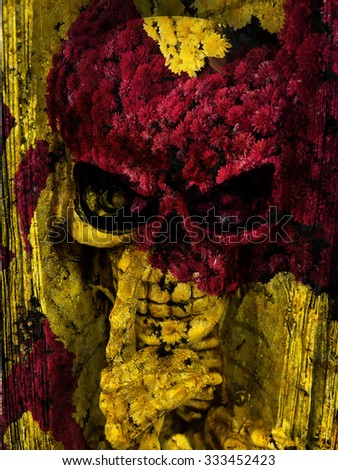 Halloween skeleton blended with the red and yellow flowers