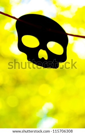 Halloween Skull with bright green background - stock photo
