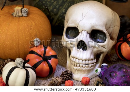 halloween skull with orange white and golden pumpkins plus other holiday decor - Halloween Skulls