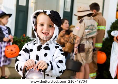 Halloween: Smiling Boy In Halloween Dalmatian Costume Trick Or Treating