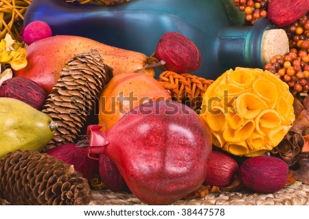 Halloween still life with blue wine bottle with cork, grapes, gourds, pumpkins, fir tree cones and leaves. - stock photo