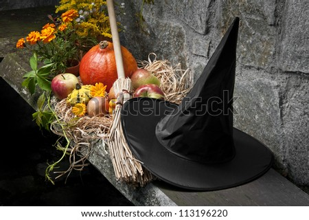 halloween still life with pumpkins and witch hat and broom - stock photo