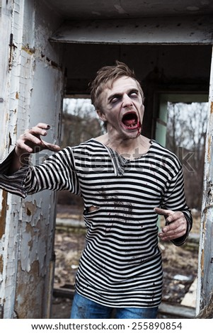 Halloween style dressed man acting like crazy - stock photo