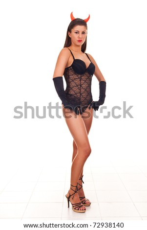 halloween style - portrait of sexy brunette with red horns - stock photo