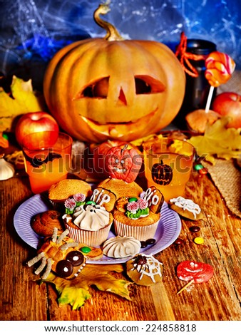 Halloween table with trick or treat. Carving pumpkin