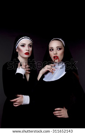 Halloween. The girls are dressed in sexy evil nuns