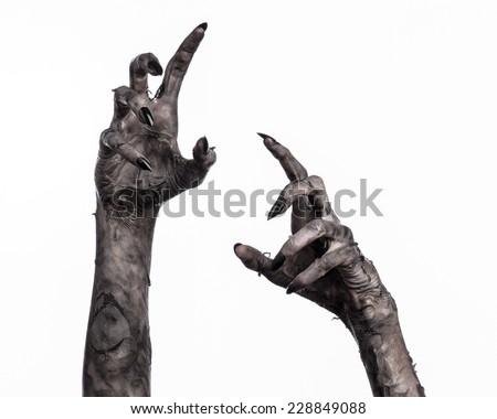 Halloween theme: terrible zombie hand with black nails - stock photo