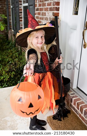 Halloween: Trick Or Treat Witch Holds Out Bucket For Candy