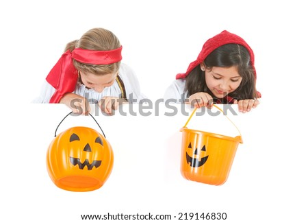 Halloween: Two Girls In Costume Looking Over White Card With Buckets