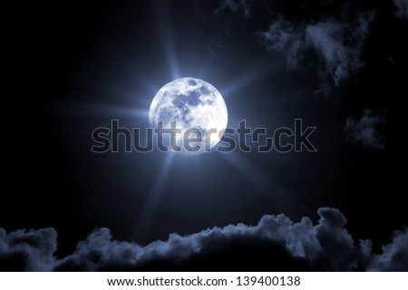 Halloween type of a full moon cloudy sky. - stock photo