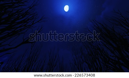 Halloween type of a full moon cloudy sky. Elements of this image furnished by NASA - stock photo