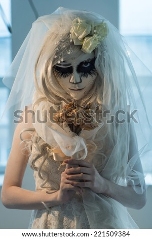 Beautiful Bride Woman Wearing Santa Muerte Mask And Wedding Dress Holding Dead Bouquet