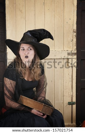 halloween witch blowing a kiss - stock photo