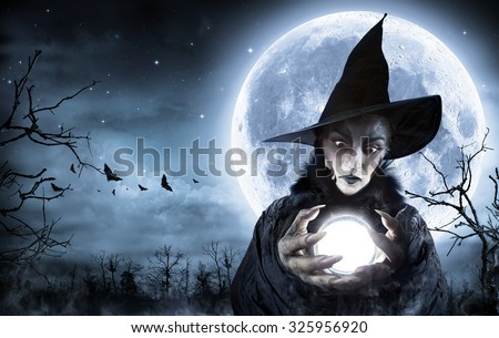 Halloween Witch Clairvoyant In A Spooky Night - Moon maps element furnished by Nasa  - stock photo