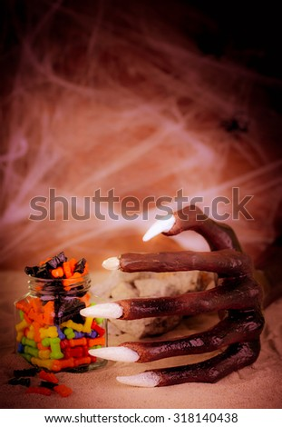 Halloween witch hand reaching for the candy close up - stock photo