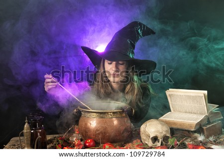 halloween witch making potions - stock photo