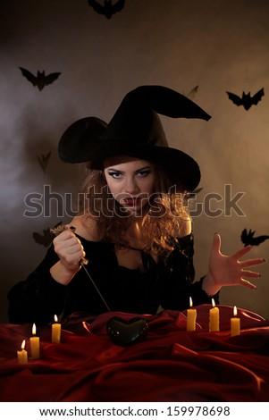 Halloween witch on dark background - stock photo