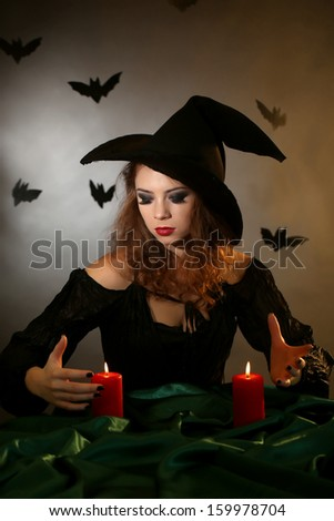 Halloween witch on dark background