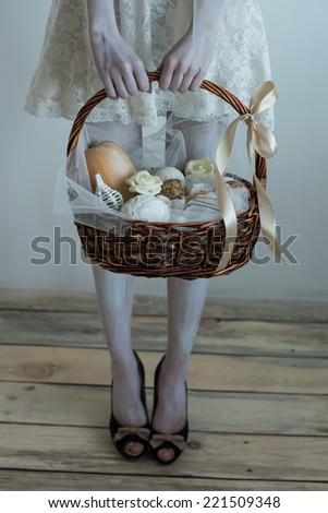Halloween witch pick up basket with treats - stock photo