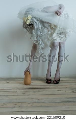 Halloween witch pick up pumpkin - stock photo