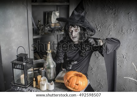 Halloween witch sitting at a table