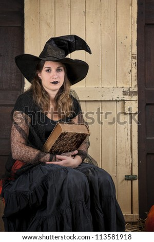 halloween witch telling a fairytale - stock photo