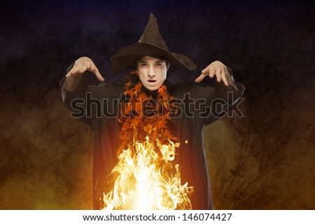 halloween witch with fire