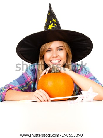 halloween, witch woman with pumpkin, smiling, white background - stock photo