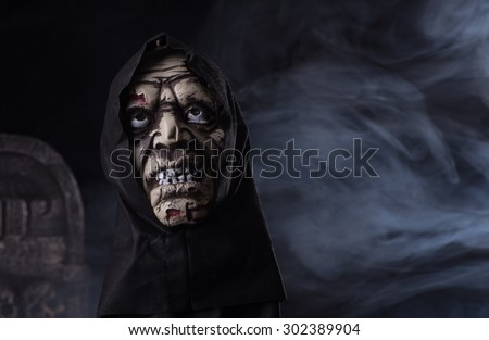 Halloween zombie prop on a dark smoky background - stock photo