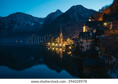 Hallstatt at night by Salzburg, Austria, traditional austrian wood village, UNESCO world culture heritage site - stock photo