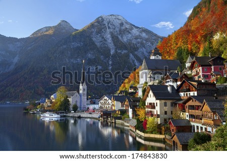 Hallstatt, Austria. Image of famous alpine village Halstatt during colourful fall morning. - stock photo