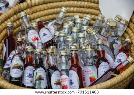 Hallstatt, Austria - June, 2017: souvenir alcohol bottles with different tastes for sale in street store. typical austrian souvenir.