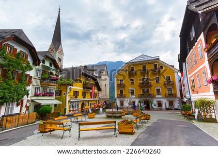 HALLSTATT, AUSTRIA - 21 JUNE 2014: Town square in Hallstatt, Austria. Hallstatt is historical village located in Austrian Alps at the Hallstatter lake and promoted by UNESCO World Heritage region. - stock photo