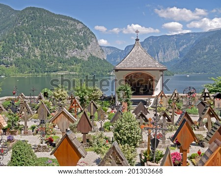 HALLSTATT, AUSTRIA - 26 June 2014: View from the graveyard of the catholic church of Hallstatt over the lake. Hallstatt in Upper Austria is a famous landmark and a UNESCO World Heritage.  - stock photo