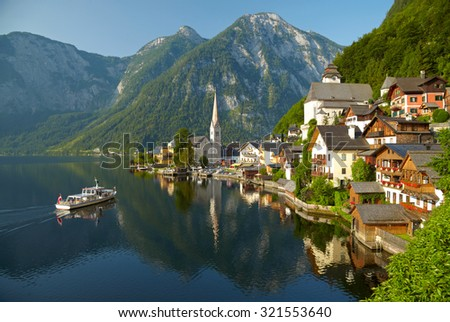 Hallstatt village and alpine lake in morning lights. Austrian Alps - stock photo