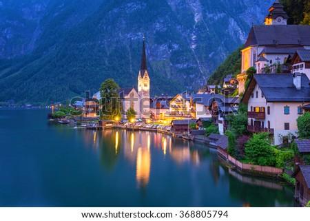 Hallstatt village in Alps at dusk, Austria - stock photo