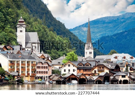 Hallstatt village in Alps at misty day, Austria - stock photo