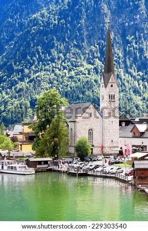 Hallstatt village in Alps at misty day, Austria - stock photo