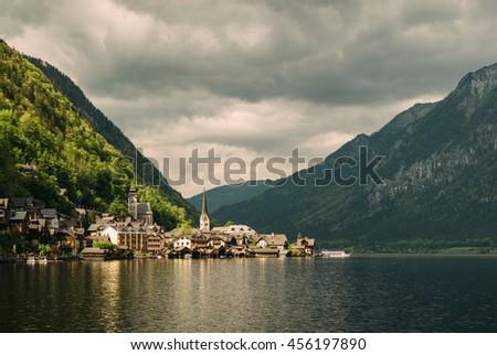 Hallstatt village in Alps reflected mountain lake. UNESCO heritage site. Gosausee, Tirol, Austria  - stock photo