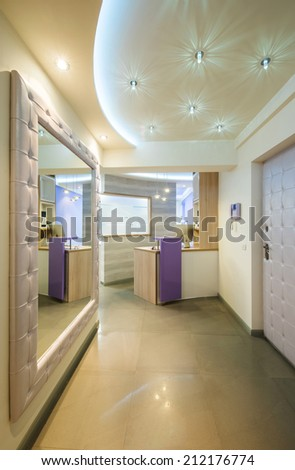 Hallway and a small reception desk  - stock photo