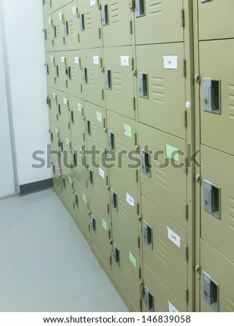 Hallway and lockers in a empty factory. - stock photo