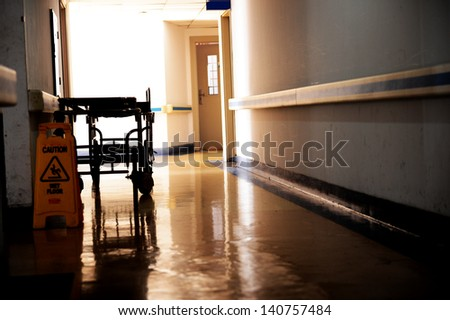 hallway in hospital with bed. - stock photo