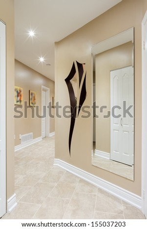 Hallway interior in a new house  with art design on the wall
