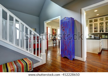 Hallway interior in classic American house. Hardwood floor and sharpen blue painted cabinet