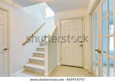 Hallway Interior In Light Tones With Hardwood Floor And Carpet Stairs.  Northwest, USA
