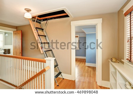 Hallway Interior With Folding Attic Ladder. Northwest, USA