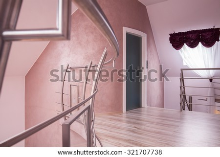 Hallway with a staircase in the house  - stock photo